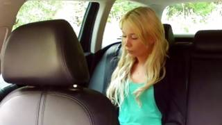 Light haired vicious wench is posing sexy in a car