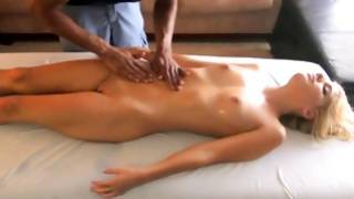 Light-haired beauty is massaged by black mister